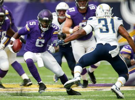 Minnesota Vikings quarterback Teddy Bridgewater (5) scrambles upfield ahead of San Diego Chargers cornerback Adrian Phillips (31) during the first half of an NFL preseason football game Sunday, Aug. 28, 2016, in Minneapolis. (AP Photo/Jim Mone)