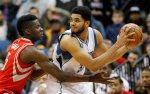 Minnesota Timberwolves center Karl-Anthony Towns, right, tries to drive under pressure from Houston Rockets forward Clint Capela, left, during the second half of an NBA basketball game in Minneapolis, Monday, April 11, 2016. The Rockets won 129-105. (AP Photo/Ann Heisenfelt)