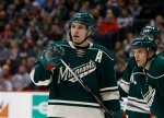 Minnesota Wild left wing Zach Parise (11) gets into position for a face-off during the second period of an NHL hockey game against the Colorado Avalanche in St. Paul, Minn., Saturday, Dec. 5, 2015. (AP Photo/Ann Heisenfelt)