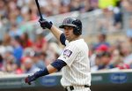 Minnesota Twins' Brian Dozier warms up on deck in a baseball game against the Detroit Tigers, Saturday, July 11, 2015, in Minneapolis. AP Photo/Jim Mone)
