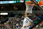 Minnesota Timberwolves forward Andrew Wiggins (22) puts the ball in the hoop in the first half of an NBA basketball game against the Dallas Mavericks, Sunday, April 3, 2016, in Minneapolis. (AP Photo/Stacy Bengs)