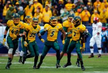 North Dakota State cornerback Jordan Champion (5) celebrates with linebacker Nick DeLuca (49), safety Robbie Grimsley (35) and safety Tre Dempsey (3) after intercepting a pass against Jacksonville State after the FCS championship NCAA college football game, Saturday, Jan. 9, 2016, in Frisco, Texas.  North Dakota State beat Jacksonville State 37-10 to win their fifth consecutive championship.  (AP Photo/Mike Stone)