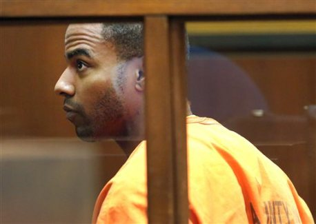 FILE - In this April 18, 2014 file photo, former NFL football All-Pro safety Darren Sharper appears in Superior Court in Los Angeles. Rape charges have been filed in Las Vegas against former NFL safety Darren Sharper, who already faces sexual assault charges in Los Angeles, New Orleans and the Phoenix area. Sharper's Las Vegas attorney, David Chesnoff, appeared Friday, March 20, 2015,  before a Las Vegas judge on two sexual assault charges involving two women in January 2014. (AP Photo/Nick Ut, File)