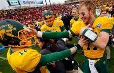 North Dakota State quarterbacks Carson Wentz (11) and Easton Stick (12) celebrate after they defeated Jacksonville State 37-10 in the FCS championship NCAA college football game, Saturday, Jan. 9, 2016, in Frisco, Texas.  (AP Photo/Mike Stone)