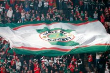 Minnesota Wild fans pass a giant flag through the crowd before the team's home opener against the St. Louis Blues in an NHL hockey game in St. Paul, Minn., Saturday, Oct. 10, 2015. (AP Photo/Ann Heisenfelt)