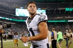 FILE - In this Sept. 3, 2015, file photo, Philadelphia Eagles quarterback Tim Tebow (11) leaves the field after a preseason NFL football game against the New York Jets in East Rutherford, N.J. Two people familiar with the move say the Eagles released Tebow. Both sources spoke on condition of anonymity, Saturday, Sept. 5, 2015, because the team hasn't announced the decision. (AP Photo/Mel Evans, File)