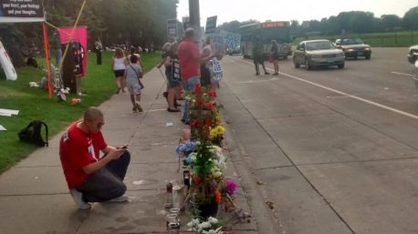 curbside flowers at Philando Castile shooting site in Falcon Heights