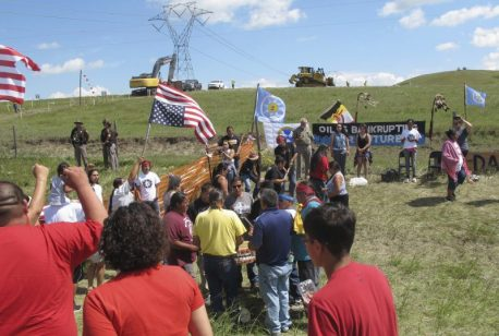 FILE - In this Aug. 12, 2016, file photo, Native Americans protest the Dakota Access oil pipeline near the Standing Rock Sioux reservation in southern North Dakota. Morton County Sheriff Kyle Kirchmeier said Thursday, Aug. 18, 2016, that the developers of a $3.8 billion, four-state oil pipeline have agreed to halt construction of the project in North Dakota until a federal court hearing next week in Washington, D.C. The Standing Rock Sioux Tribe is suing federal regulators for approving permits for the pipeline that will move oil from North Dakota to Illinois. (AP Photo/James MacPherson, File)