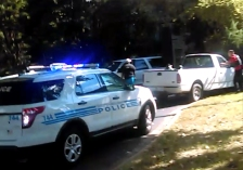 In this image taken from video recorded by Rakeyia Scott on Tuesday, Sept. 20, 2016, her husband, Keith Lamont Scott, center, stands amid Charlotte police cars and other vehicles moments before he is shot by a police officer in Charlotte, N.C. In the video of the deadly encounter, Rakeyia Scott repeatedly tells officers her husband, who is black, is not armed and pleads with them not to shoot him as they shout at him to drop a gun. The video does not show clearly whether Scott had a gun. (Rakeyia Scott/Curry Law Firm via AP)