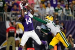 Minnesota Vikings wide receiver Stefon Diggs (14) catches a 25-yard touchdown pass over Green Bay Packers cornerback Damarious Randall, right, during the second half of an NFL football game Sunday, Sept. 18, 2016, in Minneapolis. (AP Photo/Andy Clayton-King)