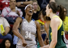 Minnesota Lynx's Sylvia Fowles (34) reacts after scoring and being fouled on the shot by Seattle Storm's Breanna Stewart, right, in the second half of a WNBA basketball game Sunday, May 22, 2016, in Seattle. The Lynx won 78-71. (AP Photo/Elaine Thompson)