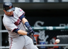 Minnesota Twins' Brian Dozier hits an one-run single during the sixth inning of a baseball game against the Chicago White Sox in Chicago, Thursday, June 30, 2016. (AP Photo/Nam Y. Huh)