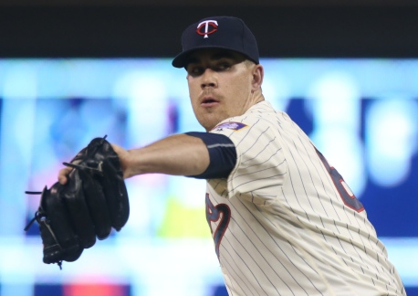 Minnesota Twins pitcher Trevor May throws against the Cleveland Indians in the 11th inning of a baseball game Sunday, July 17, 2016, in Minneapolis. The Twins won 5-4 in 11 innings, with May picking up the win. (AP Photo/Jim Mone)