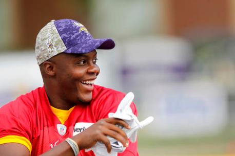 Minnesota Vikings quarterback Teddy Bridgewater (5) smiles at fans chanting his name during the first day of NFL football training camp at Mankato State University in Mankato, Minn. on Friday, July, 29, 2016.(AP Photo/Andy Clayton-King)