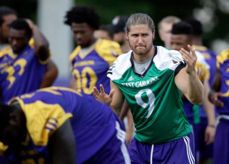 In this photo taken Thursday, Aug. 11, 2016, East Carolina quarterback Philip Nelson (9) calls a play during an NCAA college football practice in Greenville, N.C. (AP Photo/Gerry Broome)