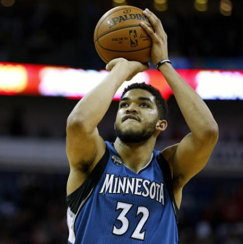 FILE - In this Feb. 27, 2016, file photo, Minnesota Timberwolves center Karl-Anthony Towns (32) shoots the ball during the second half of an NBA basketball game, in New Orleans. Towns has been tabbed to be the face of 2K's mobile companion application to NBA 2K17 video game, which is set to launch on Sept. 8. The reigning rookie of the year will be the icon cover athlete for MyNBA2K17, the latest in a series of high-profile endorsements for Towns. (AP Photo/Jonathan Bachman, File)