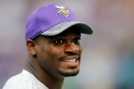 Minnesota Vikings running back Adrian Peterson laughs on the field before an NFL preseason football game against the San Diego Chargers Sunday, Aug. 28, 2016, in Minneapolis. (AP Photo/Andy Clayton-King)
