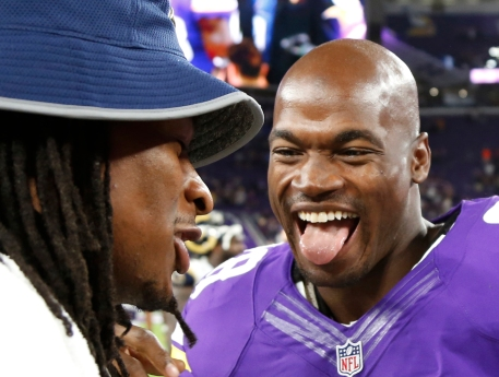 """FILE - In this Sept. 1, 2016, file photo, Minnesota Vikings running back Adrian Peterson, right, talks with Los Angeles Rams running back Todd Gurley, left, after an NFL preseason football game, in Minneapolis. Peterson can hardly sleep, so eager for the Vikings to finally open the season after their playoff loss last January. """"I've been wired up, and I'll be ready to roll Sunday,'' Peterson said. (AP Photo/Andy Clayton-King, File)"""