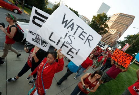 A line of protesters against the construction of the Dakota Access oil pipeline on the Standing Rock Reservation in North Dakota head to a unity rally on the west steps of the State Capitol late Thursday, Sept. 8, 2016, in Denver. (AP Photo/David Zalubowski)