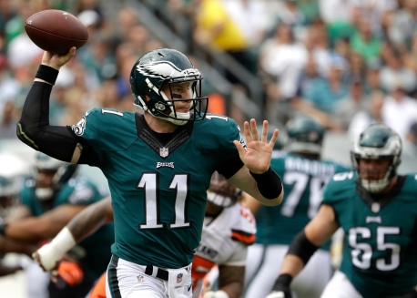 FILE - In this Sunday, Sept. 11, 2016, file photo, Philadelphia Eagles quarterback Carson Wentz passes during an NFL football game against the Cleveland Browns in Philadelphia. The No. 2 overall draft pick, Wentz will try to build on an impressive debut when the Philadelphia Eagles visit the Chicago Bears on Monday night., Sept. 19. Wentz threw for 278 yards and two touchdowns against the Eagles, completing 22 of 37 passes in a turnover-free performance and posting a 101.0 rating. (AP Photo/Matt Rourke, File)