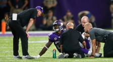 FILE - In this Sept. 18, 2016, file photo, Minnesota Vikings running back Adrian Peterson (28) talks with head coach Mike Zimmer, left, after getting injured during the second half of an NFL football game against the Green Bay Packers, in Minneapolis. Peterson hobbled out of the stadium on crutches. Sam Bradford was shaking his left hand in pain for most of the game. The Vikings took their lumps in a 17-14 win over the Packers on Sunday night, largely due to an offensive line that is struggling to protect the team's playmakers.  (AP Photo/Jim Mone, File)