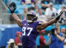 Minnesota Vikings' Everson Griffen (97) celebrates after a sack against the Carolina Panthers in the second half of an NFL football game in Charlotte, N.C., Sunday, Sept. 25, 2016. The Vikings won 22-10. (AP Photo/Bob Leverone)