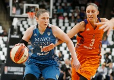 Phoenix Mercury's' Diana Taurasi, right, tries to reach the ball as Minnesota Lynx's Lindsay Whalen drives in the first quarter of a WNBA playoff semi-finals basketball game Wednesday, Sept. 28, 2016, in St. Paul, Minn. (AP Photo/Jim Mone)