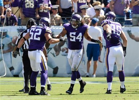 Minnesota Vikings linebacker Eric Kendricks (54) is congratulated by Chad Greenway (52) and Rhett Ellison (85) after Kendricks returned an intercepted pass 77 yards for a touchdown against the Tennessee Titans in the second half of an NFL football game Sunday, Sept. 11, 2016, in Nashville, Tenn. (AP Photo/James Kenney)