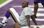Minnesota Vikings running back Adrian Peterson warms up before an NFL football game against the Green Bay Packers Sunday, Sept. 18, 2016, in Minneapolis. (AP Photo/Andy Clayton-King)