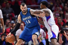Minnesota Timberwolves center Nikola Pekovic (14), of Montenegro,  battles Los Angeles Clippers center DeAndre Jordan (6) in the first half of an NBA basketball game, Monday, March 9, 2015, in Los Angeles.(AP Photo/Gus Ruelas)