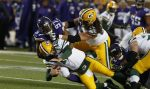 Green Bay Packers quarterback Aaron Rodgers (12) is tackled by Minnesota Vikings defensive end Everson Griffen (97) during the first half of an NFL football game in Minneapolis, Sunday, Nov. 22, 2015. (AP Photo/Jim Mone)