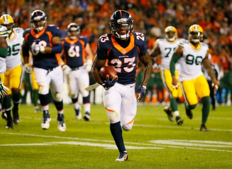 Denver Broncos running back Ronnie Hillman (23) runs for a touchdown during an NFL football game between the Denver Broncos and the Green Bay Packers, Sunday, Nov. 1, 2015, in Denver. (AP Photo/Jack Dempsey)