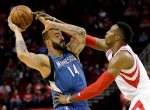 Houston Rockets' Dwight Howard, right, tries to knock the ball away from Minnesota Timberwolves' Nikola Pekovic (14) during the first quarter of an NBA basketball game Wednesday, Jan. 13, 2016, in Houston. (AP Photo/David J. Phillip)