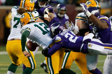 Green Bay Packers quarterback Aaron Rodgers (12) is sacked by Minnesota Vikings cornerback Captain Munnerlyn (24) during the first half of an NFL football game in Minneapolis, Sunday, Nov. 22, 2015. (AP Photo/Jim Mone)