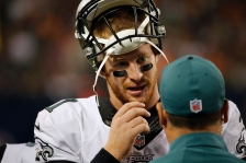Philadelphia Eagles quarterback Carson Wentz (11) talks to a coach on the sideline during the second half of an NFL football game against the Chicago Bears, Monday, Sept. 19, 2016, in Chicago. (AP Photo/Charles Rex Arbogast)
