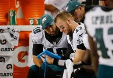 Philadelphia Eagles quarterbacks Carson Wentz (11)  Chase Daniel (10) check a computer tablet on the sideline during the first half of an NFL football game against the Chicago Bears, Monday, Sept. 19, 2016, in Chicago. (AP Photo/Charles Rex Arbogast)