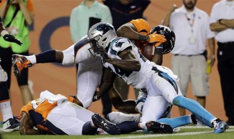 Denver Broncos running back C.J. Anderson (22) scores a touchdown as Carolina Panthers cornerback James Bradberry (24) defends during the second half of an NFL football game, Thursday, Sept. 8, 2016, in Denver. (AP Photo/Joe Mahoney)