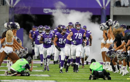 Minnesota Vikings players run onto the field before an NFL preseason football game against the Los Angeles Rams Thursday, Sept. 1, 2016, in Minneapolis. (AP Photo/Andy Clayton-King)