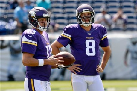 Minnesota Vikings quarterbacks Shaun Hill (13) and Sam Bradford (8) warm up before an NFL football game against the Tennessee Titans Sunday, Sept. 11, 2016, in Nashville, Tenn. (AP Photo/Mark Zaleski)