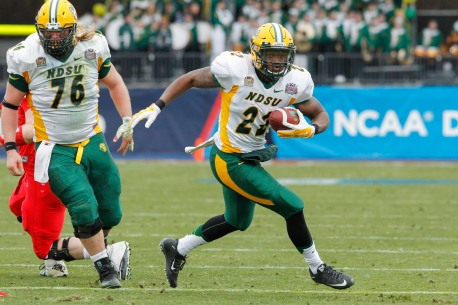 North Dakota State running back King Frazier carries the ball during the FCS Championship NCAA college football game against Illinois State Saturday, Jan. 10, 2015, in Frisco, Texas.   North Dakota State won the game 29-27 for their fourth straight national championship.  (AP Photo/Tim Sharp)