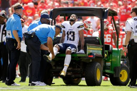 San Diego Chargers wide receiver Keenan Allen (13) grimaces as he is carted off the field during the first half of an NFL football game against the Kansas City Chiefs in Kansas City, Mo., Sunday, Sept. 11, 2016. (AP Photo/Charlie Riedel)