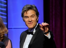 """FILE - This June 16, 2013 file photo shows Mehmet Oz, aka Dr. Oz, accepting the award for outstanding talk show: informative for """"The Dr. Oz Show"""" at the 40th Annual Daytime Emmy Awards in Beverly Hills, Calif. Oz is following in the footsteps of TV personalities like Oprah Winfrey, Rachael Ray and Martha Stewart by launching his own women's magazine. The Emmy Award-winning host has teamed up with Hearst to release the lifestyle magazine. In a statement, Oz said it """"will provide women with everything they need to feel inspired and live a long, healthy, joyful life."""" Two trial issues will be released in the first quarter of 2014.  (Photo by Chris Pizzello/Invision/AP, file)"""