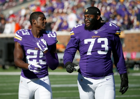 Minnesota Vikings cornerback Xavier Rhodes (29) and defensive tackle Sharrif Floyd (73) walk on the field before an NFL football game against the Kansas City Chiefs, Sunday, Oct. 18, 2015, in Minneapolis. (AP Photo/Ann Heisenfelt)