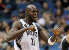 Minnesota Timberwolves forward Kevin Garnett (21) reacts after teammate Karl-Anthony Towns scored during the second half of an NBA basketball game against the Sacramento Kings in Minneapolis, Friday, Dec. 18, 2015. The Timberwolves won 99-95. (AP Photo/Ann Heisenfelt)