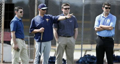 Tampa Bay Rays President of Baseball Operation Matt Silverman, from left, manager Kevin Cash, Erik Neander and Chaim Bloom, right, both vice presidents of baseball operations watch baseball spring training in Port Charlotte, Fla., Monday March 2, 2015. (AP Photo/Tony Gutierrez)