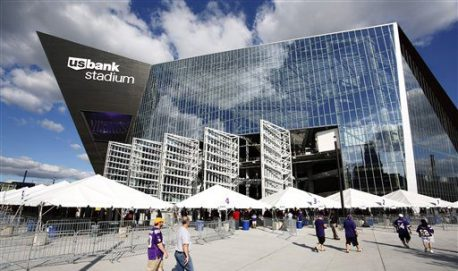 Fans arrive at U.S. Bank Stadium before an NFL preseason football game between the Minnesota Vikings and the Los Angeles Rams Thursday, Sept. 1, 2016, in Minneapolis. (AP Photo/Andy Clayton-King)