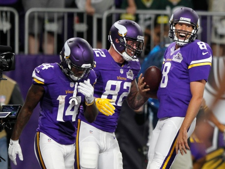 Minnesota Vikings tight end Kyle Rudolph, center, celebrates with teammates Stefon Diggs, left, and quarterback Sam Bradford, right, after catching an 8-yard touchdown pass during the first half of an NFL football game against the Green Bay Packers Sunday, Sept. 18, 2016, in Minneapolis. (AP Photo/Andy Clayton-King)