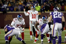 New York Giants quarterback Eli Manning (10) directs the offense during the first half of an NFL football game against the Minnesota Vikings, Sunday, Dec. 27, 2015, in Minneapolis. (AP Photo/Ann Heisenfelt)