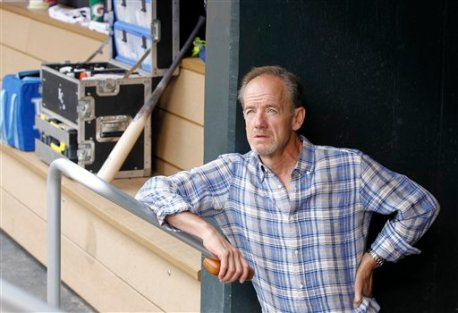 Minnesota Twins owner Jim Pohlad looks out of the visitors' dugout before a baseball game between the Minnesota Twins and the Kansas City Royals in Minneapolis, Sunday, Aug. 17, 2014. (AP Photo/Ann Heisenfelt)
