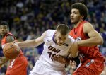 Northern Iowa forward Seth Tuttle drives past Illinois State center Reggie Lynch during the first half of an NCAA college basketball game, Wednesday, Feb. 11, 2015, in Cedar Falls, Iowa. (AP Photo/Charlie Neibergall)